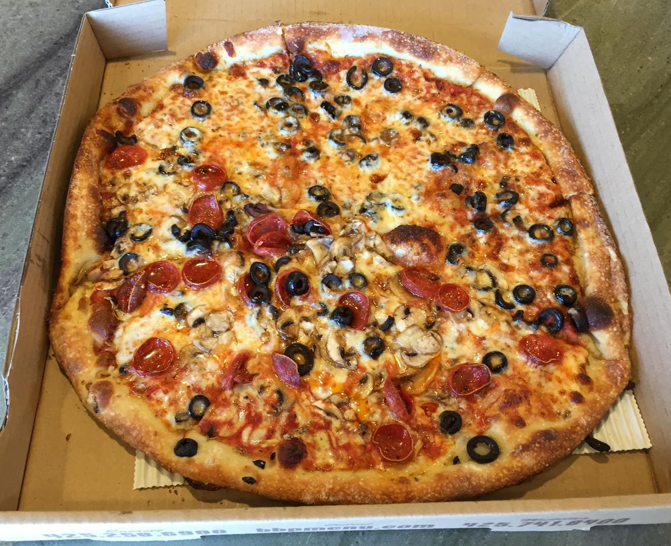 14 inch black olive, half pepperoni and mushroom.  Purchased and consumed April 12th, 2015